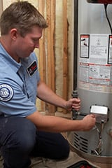 Technician working on a water heater